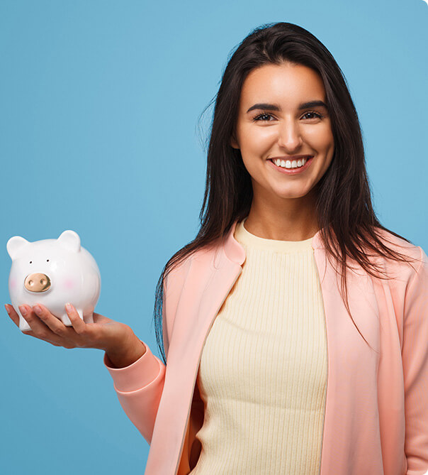 woman smiling holding a piggy bank