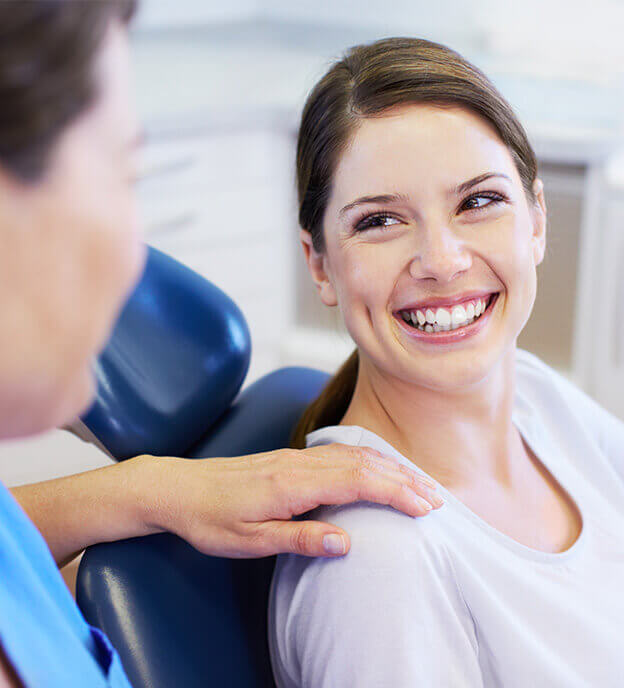 Woman speaking to the dentist during her visit